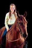 Vaquera joven con su caballo Fotos de archivo