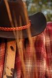 Vaquero Clothes Hanging con la paja en primero plano Imagen de archivo