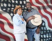 Vaquero Couple Honoring Country fotografía de archivo