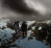 Vaquero debajo de la tormenta fotografía de archivo libre de regalías