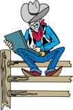 Vaquero en la computadora portátil Foto de archivo