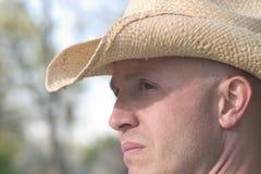 Vaquero en sombrero de paja Foto de archivo