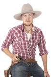 Vaquero joven con la pistola exhausta Fotografía de archivo