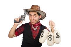 Vaquero joven con los bolsos del arma y del dinero aislados encendido fotos de archivo libres de regalías