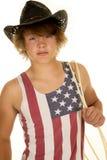 Vaquero joven en la expresión seria del top sin mangas de la bandera Foto de archivo libre de regalías