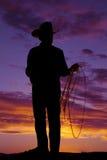 Vaquero mayor de la cuerda del hombre de la silueta Imagen de archivo libre de regalías