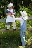 Vaquero y muchacha 2 de la pradera Imágenes de archivo libres de regalías