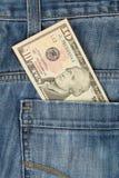 Vaqueros con el billete de dólar del americano 10 Imagen de archivo libre de regalías
