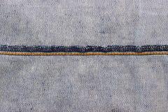 Vaqueros con la costura para la textura y el fondo Fotos de archivo