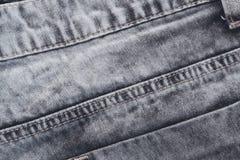 Vaqueros del vintage con las puntadas y el bolsillo, fondo de la foto Dril de algodón de los vaqueros de Boho Fotografía de archivo libre de regalías