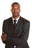 Varón afroamericano del negocio con los brazos cruzados fotografía de archivo libre de regalías