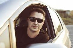 Varón alegre en coche Imágenes de archivo libres de regalías