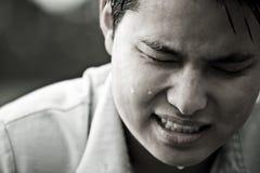 Varón asiático tensionado y presionado Imagen de archivo