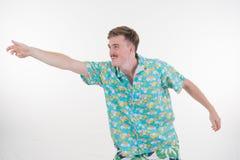 Varón atractivo feliz en la presentación colorida en el fondo blanco Fotografía de archivo libre de regalías