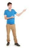 Varón casual joven que presenta algo Fotografía de archivo libre de regalías