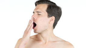 Varón con la falta de sueño, hombre que bosteza imagen de archivo libre de regalías