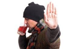 Varón con la gripe que hace gesto de la parada foto de archivo libre de regalías