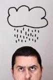 Varón con la nube de lluvia foto de archivo libre de regalías