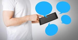 Varón con PC de la tableta Imagenes de archivo