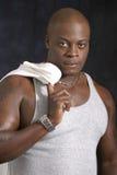 Varón del afroamericano en tapa del tanque Foto de archivo