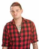 Varón enfadado en camisa de la franela Imagenes de archivo