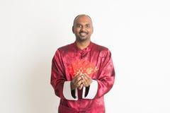 Varón indio con Año Nuevo chino Imagenes de archivo