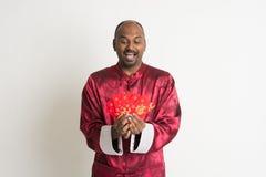 Varón indio con Año Nuevo chino Foto de archivo