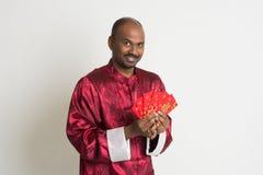 Varón indio con ropa china del Año Nuevo Imágenes de archivo libres de regalías