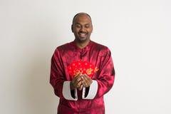 Varón indio con ropa china del Año Nuevo Fotos de archivo libres de regalías