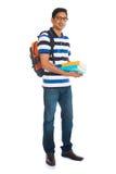 Varón indio joven de la universidad con el fondo blanco aislado Foto de archivo libre de regalías