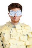 Varón joven con los ojos pintados en etiquetas engomadas Imagenes de archivo