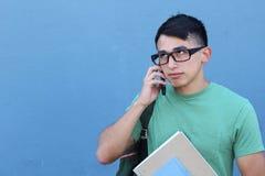 Varón joven que consigue molestado en el teléfono Imagen de archivo