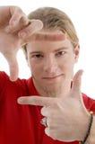 Varón que muestra gesto de mano que enmarca Fotos de archivo