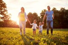 Varón y hembra con los niños al aire libre Fotografía de archivo libre de regalías