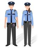 Varón y hembra de los oficiales de policía aislados en el fondo blanco Policía del hombre y de la mujer Fotografía de archivo