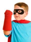 var barnet som simulerar superheroen till royaltyfria foton