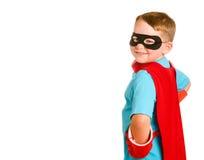 var barnet som simulerar superheroen till arkivbilder