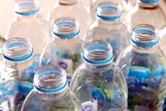 var flaskor på burk plast- återanvänt vatten Royaltyfri Foto
