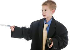 var pojkeaffärsmansimulering som är liten till Fotografering för Bildbyråer