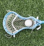 Vara azul da lacrosse de Carolina com uma bola Fotos de Stock Royalty Free