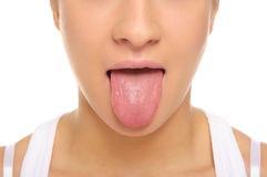 A vara da mulher umas tongue para fora imagem de stock royalty free