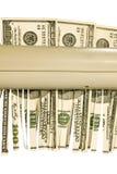vara strimlade pengar Arkivfoto