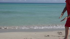 Varadero Beach in Matanzas, Cuba. Child playing in Varadero beach in Cuba featuring clear blue water and white sand, the beach is a tourist landmark, destination stock video