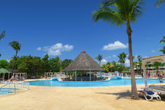 Exotic tropical resort near the smiwwing pool. Varadero, Cuba - 10 April, 2016: amazing vacation in Cuba, total relaxation time by the pool under blue tropical Stock Photography