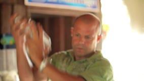 VARADERO, CUBA - DECEMBER 23, 2011: Barman with shaker stock video footage