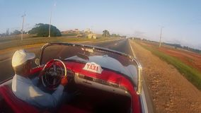 VARADERO, CUBA - DECEMBER 23, 2011: Convertible taxi driving stock video footage