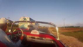 VARADERO, CUBA - DECEMBER 23, 2011: Convertible taxi driving stock video