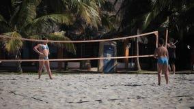 VARADERO, CUBA - DECEMBER 23, 2011: Kids playing beach volleyball. At sunny day stock video
