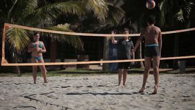 VARADERO, CUBA - DECEMBER 23, 2011: Kids playing beach volleyball. At sunny day stock video