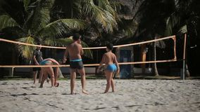 VARADERO, CUBA - DECEMBER 23, 2011: Kids playing beach volleyball. At sunny day stock footage